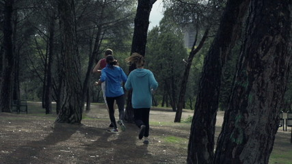Young people jogging in park, slow motion shot at 240fps