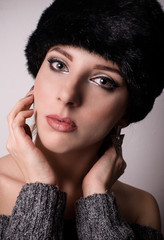 Pretty young woman in a winter fur hat