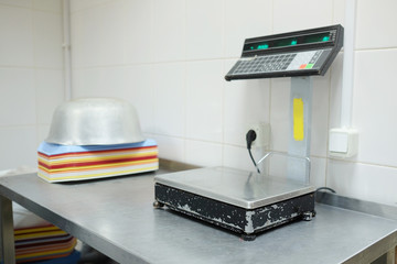 closeup industrial scales in the culinary workshop