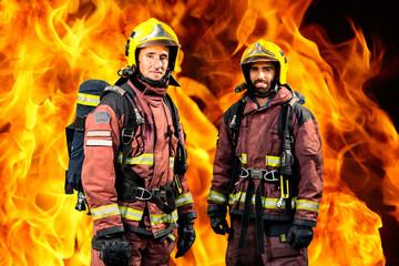Firemen against burning background.