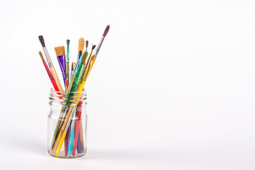 isolated paints brushes in a glass