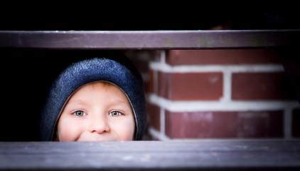 Boy under the stairs