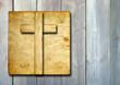 Old vintage Christian paper cross on wood