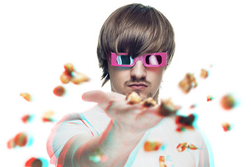 young man in stereo glasses throwing popcorn at the viewer 3d mo