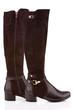 Elegant female knee high boots isolated on white