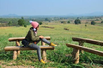Thai woman sit for rest at Viewpoint at Ban Kha