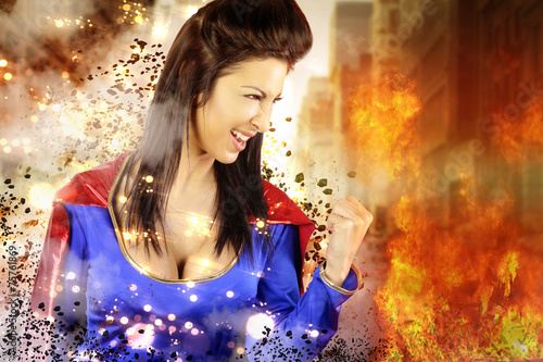 Poster young woman dressed as a superhero shows its power