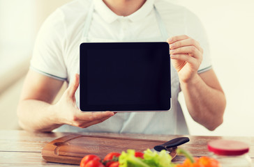 close up of male hands holding tablet pc