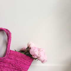 Bouquet of peonies in a bag