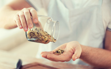 male emptying jar with white and wild black rice