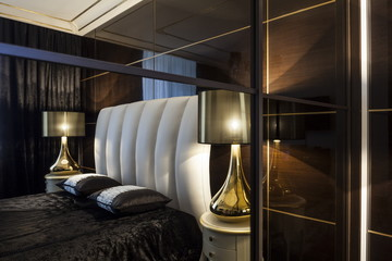 luxury modern bedroom bed and table lamps