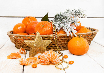 New Year with tangerines and spruce branches