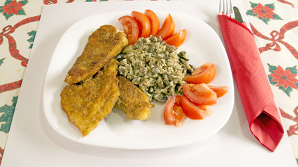 Delicious Wiener Schnitzel with lemon and tomatoes