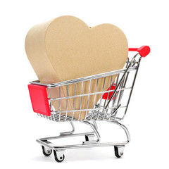 heart-shaped gift box in a shopping cart