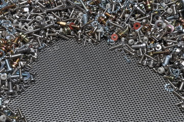 Screws nuts and bolts on steel surface