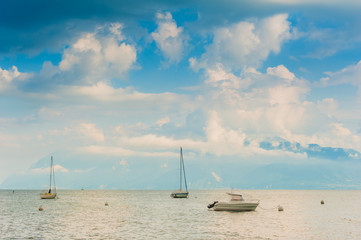 Boats on the lake with beautiful clouds