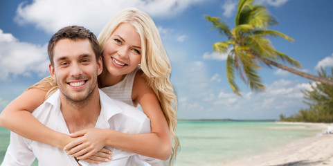 happy couple having fun over beach background