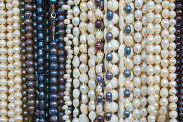 Pearl beads of various colors for sale.