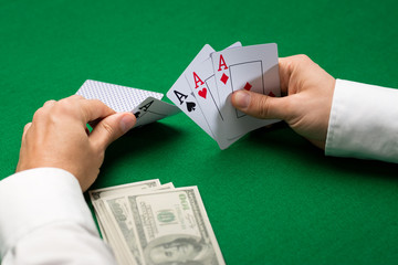 poker player with cards and money at casino
