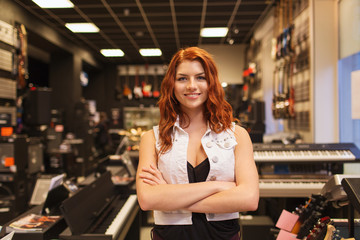 smiling assistant or customer at music store