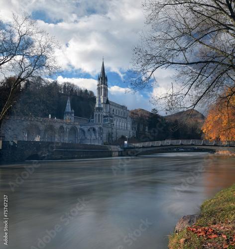 Sanctuaries of Lourdes from the border of Gave de Pau River Poster