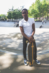 Black Boy with Longboard at Park