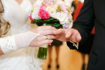 bride newlyweds wears ring groom at a wedding couple