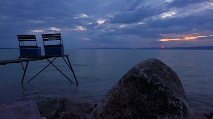 Peaceful twilight scene on Balaton lake under a cloudy sky
