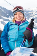 Female skier in gondola.