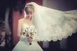 canvas print picture - Portrait of a beautiful blonde bride with wedding bouqet