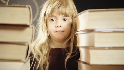 Little girl school between books