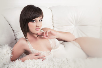 Tempting woman in white lingerie