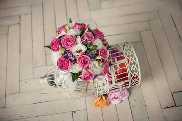 wedding bridal bouquet of roses on the wooden white  floor