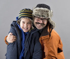Father and Son Wearing Winter Clothes