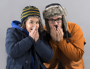 Happy Child and Father Wearing Winter Clothes