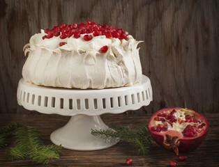 Pavlova cake with pomegranate. Meringue cake with pomegranate