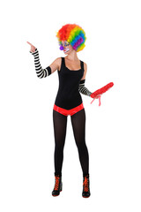 Funny clown in colorful wig, standing on white background