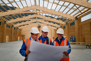 builders study the plan