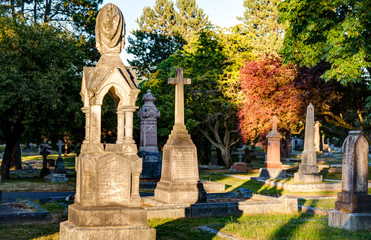 old gravestones at sunset, Ross Bay Cemetery, Victoia, BC, Canad