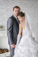 Bride and groom - white brick wall in the living room