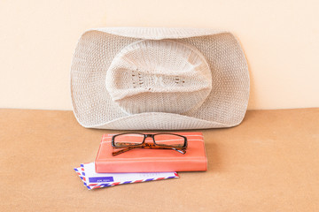 Hat,notebook, glasses and envelope on a wood background