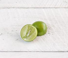 green lemon on wood background