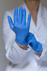 Nurse wearing protective gloves