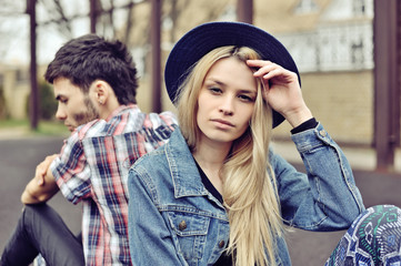 Depressed couple. Depressed young hipsters couple sitting back t