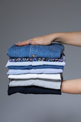 Female hands with ironed clothes