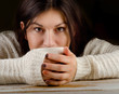 young girl with cup of  tea