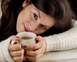 young girl with cup of hot tea