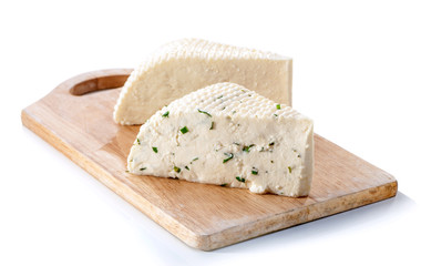 two soft cheese slabs on board isolated over white background