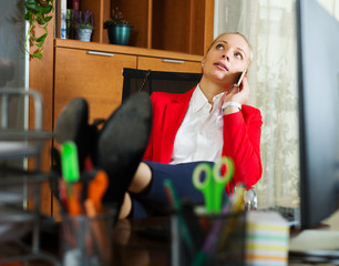 woman having a tedious time and speaking by mobile