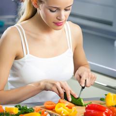 Smiling woman making salad